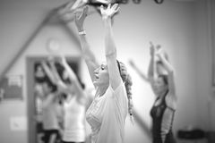 Women lifting arms  in fitness class Royalty Free Stock Image