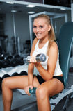 Women lifting free weights with a smile Stock Photography