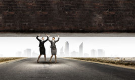 Women lifting wall Royalty Free Stock Photography