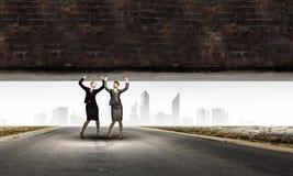 Women lifting wall Royalty Free Stock Photography