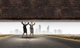 Women lifting wall Stock Photos