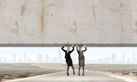 Women lifting wall Stock Photo
