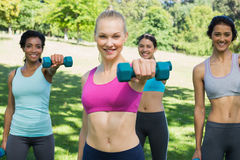Women lifting weights in park Stock Images