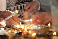Women lighting candles for a righteous who died. Women lighting candles together for a righteous who died Stock Photography