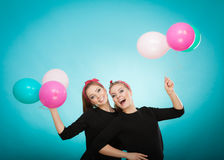 Women like a little girls want fly away by balloons. Royalty Free Stock Image