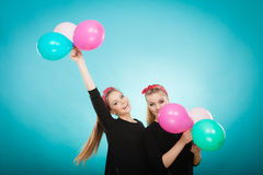 Women like a little girls want fly away by balloons. Royalty Free Stock Images