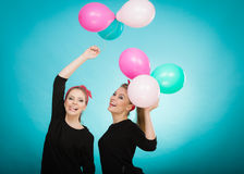 Women like a little girls want fly away by balloons. Royalty Free Stock Photos