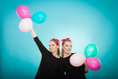 Women like a little girls want fly away by balloons. Stock Images