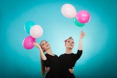 Women like a little girls want fly away by balloons. Stock Photos