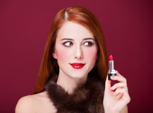 Women with lipstick. Woman in luxury fur scarf with lipstick Stock Image