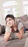 Women listen music Stock Images
