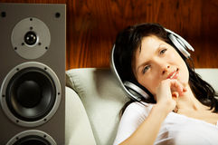 Women listening music in headphones Stock Images