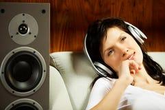 Women listening music in headphones Stock Images