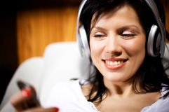 Women listening music in headphones Stock Image