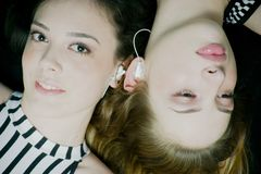 Women listening to music. Women listening music with earphone Stock Photo