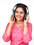 Women listening to music. Happy woman with a headphone, listening to music Stock Photography