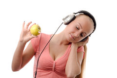 Women listening to music in headphones. Royalty Free Stock Images
