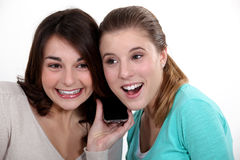 Women listening to a song Stock Photography