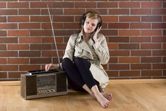 Women listens to an old radio Stock Images