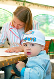 Women with a little boy in cafe Royalty Free Stock Images
