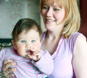 Women with a little child Stock Images