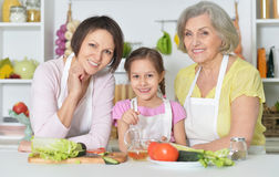 Women with little girl cooking Royalty Free Stock Photo