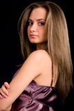 Women with long hair on black background Stock Photos