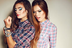 Women with long hair and bright makeup wears casual clothes Royalty Free Stock Images