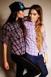 Women with long  hair and bright makeup wears casual clothes Stock Photography