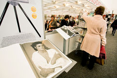 Women look at the books in a section of Taschen Stock Image