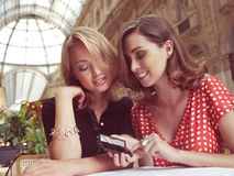 Women look at message on mobile phone Stock Images
