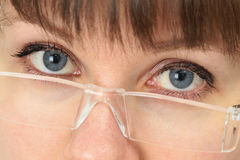 Women look over spectacles close up Royalty Free Stock Photography