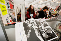 Women look at photo albums on the Book Fair Stock Photo