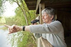 Women looking through binoculars Stock Photo