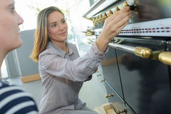 Women looking at controls range oven Stock Photography