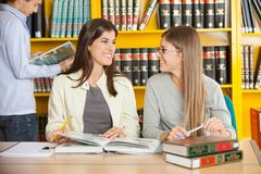 Women Looking At Each Other While Studying In Stock Photo
