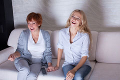 Women looking film comedy Royalty Free Stock Images