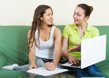 Women looking financial documents with laptop Royalty Free Stock Images