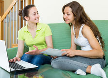 Women looking financial documents with laptop Royalty Free Stock Photo