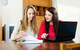 Women looking financial documents Royalty Free Stock Images