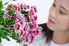 Women looking flowers Royalty Free Stock Images