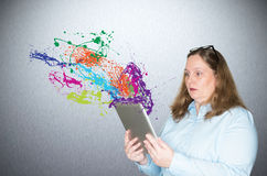 Women looking for information with the tablet Royalty Free Stock Image