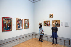 Women looking at National Gallery paintings in London Stock Photos