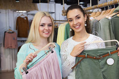 Women looking for new garments Stock Image
