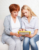 Women looking at the photo frame Royalty Free Stock Images