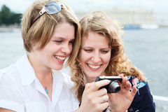 Women looking at screen of simple camera Stock Photos