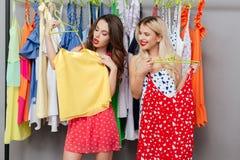 Women looking at shirt royalty free stock photography