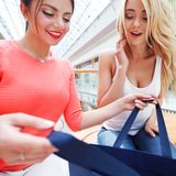 Women looking into shopping bag Royalty Free Stock Photography