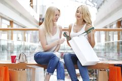 Women looking into shopping bag Stock Photography