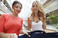 Women looking into shopping bag Stock Image